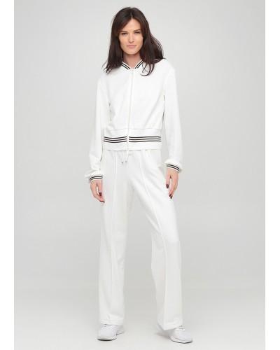 Широкі трикотажні штани білого кольору